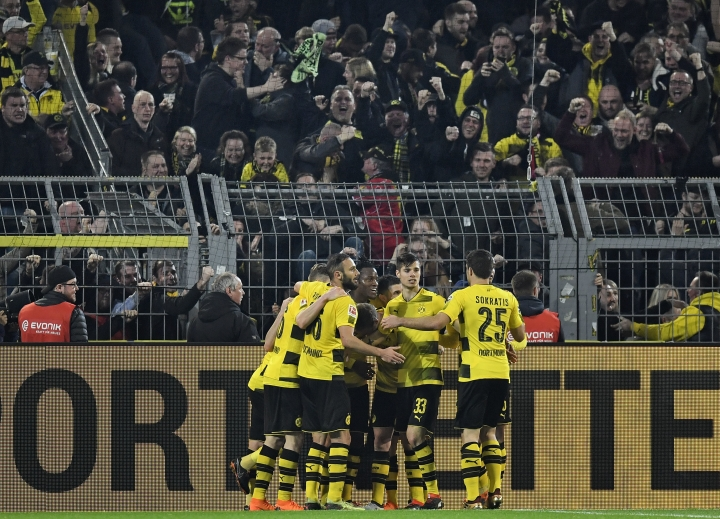 Dortmund's Michy Batshuayi is celebrated after scoring the final goal in the additional time during the German Bundesliga soccer match between Borussia Dortmund and Eintracht Frankfurt in Dortmund, Germany, Sunday, March 11, 2018. Dortmund defeated Frankfurt in a dramatic 3-2. (AP Photo/Martin Meissner)