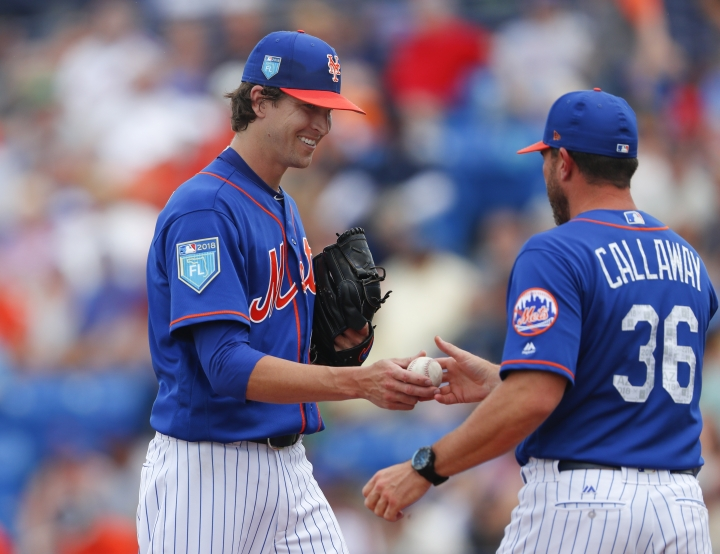 New York Mets starting pitcher Jacob deGrom (48) hands the ball to manager Mickey Callaway (36) as he is relived in the third inning of a spring training baseball game against the Houston Astros, Sunday, March 11, 2018, in Port St. Lucie, Fla. (AP Photo/John Bazemore)