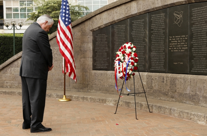 U.S. Secretary of State Rex Tillerson bows his head after laying a wreath at Memorial Park in honor of the victims of the deadly 1998 U.S. Embassy bombing in Nairobi, Kenya, Sunday, March 11, 2018. (Jonathan Ernst/Pool Photo via AP)