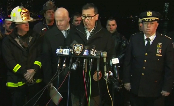 In this image made from video provided by WNYW, New York City Fire Department Commissioner Daniel Nigro speaks during a press conference a deadly helicopter crash in New York on Sunday, March 11, 2018. A helicopter crashed into New York City's East River Sunday night and flipped upside down in the water, killing at least a few people aboard and leaving some others in critical condition, officials said. New York City Police Commissioner James O'Neill stands at center left. (WNYW via AP)