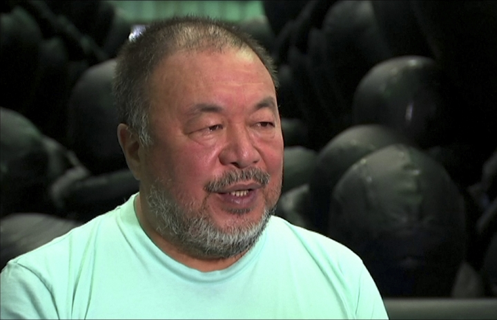 In this image made from a video, Chinese dissident artist Ai Weiwei speaks during his exhibition in Sydney, Monday, March 12, 2018. Ai said Monday that it doesn't matter whether or not China has a change in leadership, the culture and the system will always remain the same. He launched an exhibition in Sydney to highlight the international refugee crisis. (Australia Broadcasting Corporation via AP)