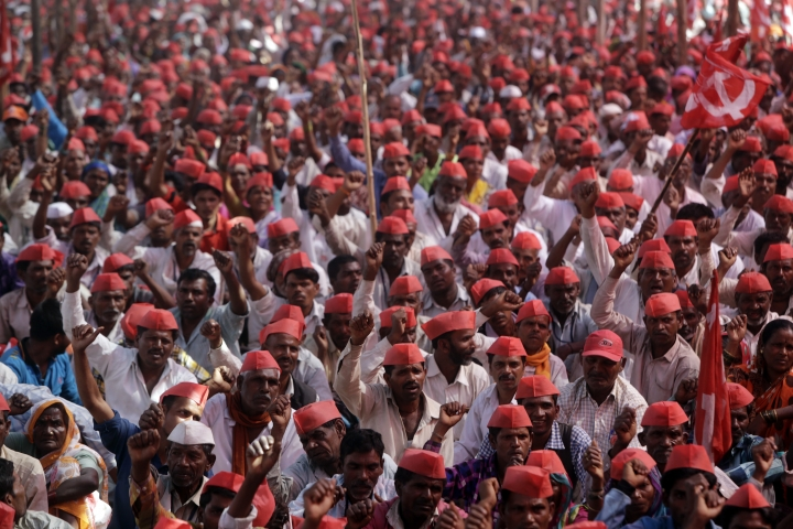 Indian farmers shout slogans during a rally at the end of their six day long march on foot, in Mumbai, India, Monday, March 12, 2018. Tens of thousands of farmers from across western India have arrived in Mumbai demanding, among other things, a waiver of farm loans and fair prices for their produce as India's agriculture sector struggles amid years of declining earnings. The farmers reached India's business capital Monday after marching on foot for up to six days and plan to surround the state legislature of the western state of Maharashtra in Mumbai. (AP Photo/Rajanish Kakade)