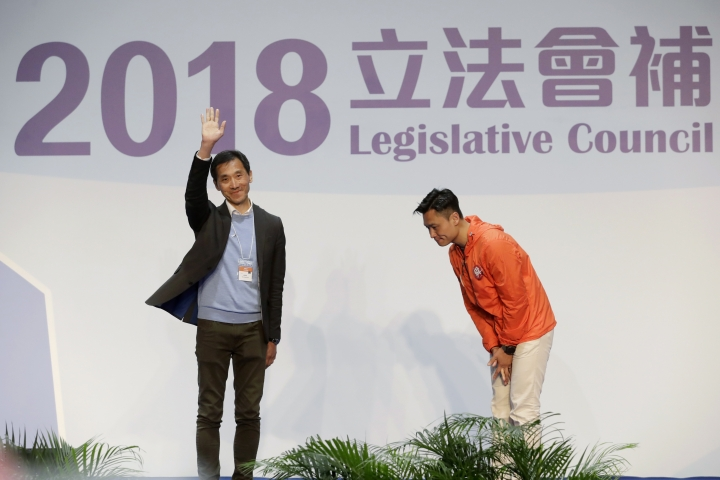 Hong Kong pro-Beijing by-election candidate Vincent Cheng Wing-shun bows at his competitor pro-democracy by-election candidate Edward Yiu after winning a seat at the legislative council by-elections in Hong Kong, Monday, March 12, 2018. Hong Kong pro-democracy candidates won back only two of four seats in a crucial by-election in the semiautonomous Chinese region, final results showed Monday. Yiu, who was the only one of the disqualified lawmakers to compete again, narrowly lost to a pro-Beijing rival after a nail-biting recount. (AP Photo/Kin Cheung)