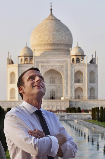 French President Emmanuel Macron admires the Taj Mahal, in Agra, India, Sunday, March 11, 2018. (Atul Yadav/Press Trust of India via AP)