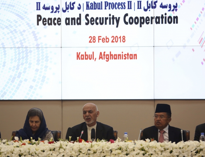 FILE - In this Wednesday, Feb. 28, 2018 file photo, Afghanistan's President Ashraf Ghani, center, speaks during the 2nd Kabul Process conference at the Presidential Palace in Kabul. Ghani has put a peace offer on the table, and analysts say the ball is now in the Taliban's court, yet there are no signs the Taliban want to play and some indication they are not interested, at least not yet. (AP Photo/Rahmat Gul, File)