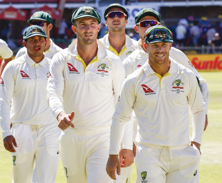 Australia's David Warner, right, leads his team off the field after losing the second cricket test between South Africa and Australia at St. George's Park in Port Elizabeth, South Africa, Monday, March 12, 2018. (AP Photo/Michael Sheehan)