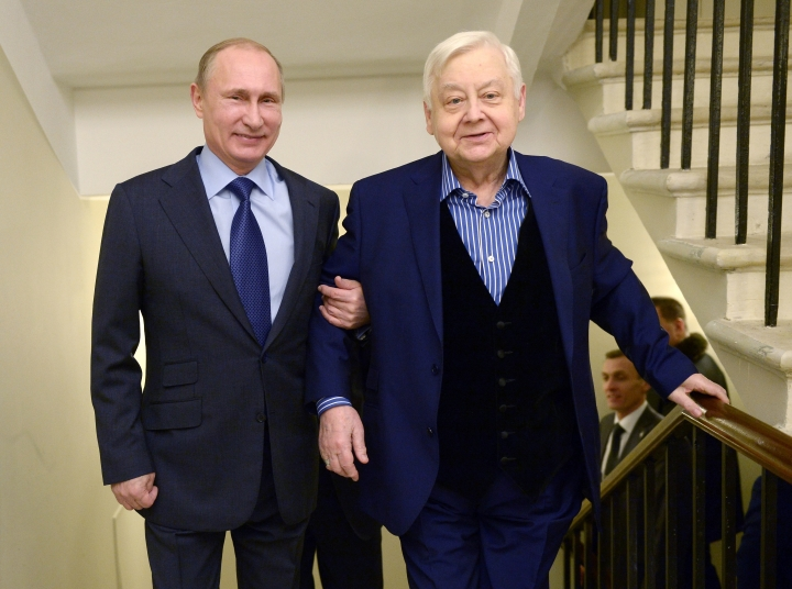 FILE In this Wednesday, Jan. 28, 2015 file photo artistic director of Moscow's Chekov Theater Oleg Tabakov, right, and Russian President Vladimir Putin, walk in the theater to open the Year of Literature in Moscow, Russia. Oleg Tabakov, a Russian actor and theater director who has been one of the most revered figures in the Russian theater community and film industries for decades, has died. He was 82. (Alexei Nikolsky, Sputnik, Kremlin Pool Photo via AP, File)