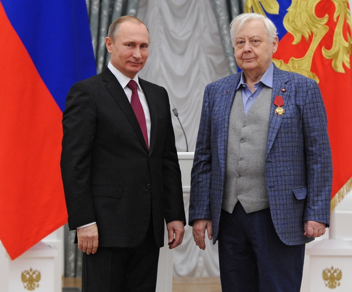 FILE In this file photo taken on Thursday, Dec. 10, 2015, Russian President Vladimir Putin, left, gives a medal to artistic director of the Chekhov Moscow Art Theater Oleg Tabakov during an award ceremony in the Kremlin in Moscow, Russia. Oleg Tabakov, a Russian actor and theater director who has been one of the most revered figures in the Russian theater community and film industries for decades, has died. He was 82. (Mikhail Klimentyev/Sputnik, Kremlin Pool Photo via AP, File)