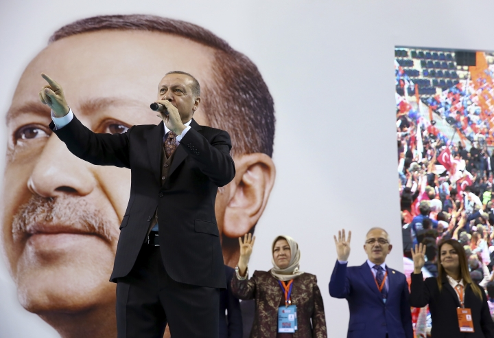 "Turkey's President Recep Tayyip Erdogan, gestures as he delivers a speech during a rally of his ruling Justice and Development (AKP) Party's supporters, in Mersin, southern Turkey, Saturday, March 10, 2018. Erdogan has criticised NATO for not supporting the country's ongoing military operation against the Syrian Kurdish People's Protection Units or YPG, that started Jan. 20, to clear them from Afrin in northwestern Syria. Erdogan asked, ""Hey NATO, where are you?"" and accused the alliance of double standards.(Kayhan Ozer/Pool Photo via AP)"