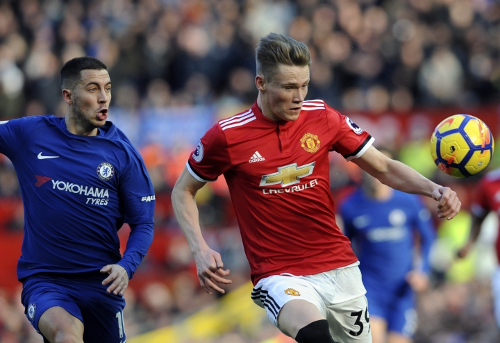 FILE - In this Sunday, Feb. 25, 2018 file photo, Manchester United's Scott McTominay, right, duels for the ball with Chelsea's Eden Hazard during their English Premier League soccer match at the Old Trafford stadium in Manchester, England. Scott McTominay, an unfussy 21-year-old midfielder, has established himself as a key player for Manchester United this season. United manager Jose Mourinho admires his humbleness and willing to learn and has started McTominay over record signing Paul Pogba at times this season. McTominay is likely to play against Sevilla in the second leg of their Champions League last-16 matchup on Tuesday, March 13. (AP Photo/Rui Vieira, file)