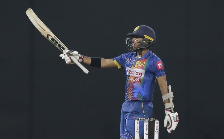 Sri Lankas' Kusal Mendis celebrates scoring a half century against India during their Twenty20 cricket match in Nidahas triangular series in Colombo, Sri Lanka, Monday, March 12, 2018. (AP Photo/Eranga Jayawardena)