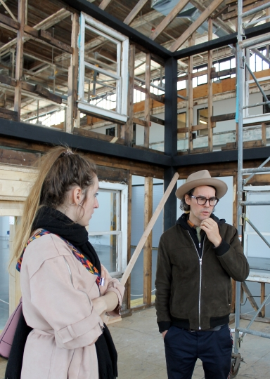 In this Sunday, March 11, 2018, photo, artist Ryan Mendoza and his wife, Fabia, stand inside the partially assembled house, where Rosa Parks once lived in Detroit, in the WaterFire Arts Center in Providence, R.I. Mendoza says he is working to push forward with a display of the house after Brown University canceled it, citing an unspecified dispute involving the Rosa and Raymond Parks Institute for Self Development. (AP Photo/Michelle R. Smith)