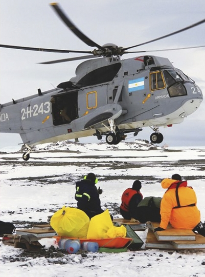 This Sunday, March 11, 2018 photo distributed by Argentina's Navy shows an Argentina helicopter landing to rescue stranded American scientists on Joinville Island in Antarctica, south of the Argentine mainland. An Argentine icebreaker has rescued the five American scientists who were stranded in the island off the northeast tip of the Antarctic Peninsula. (Argentina Navy via AP)