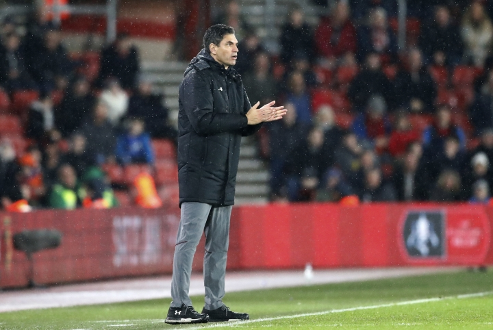 "FILE - A Sunday, Jan. 21, 2018 file photo showing Southampton manager Mauricio Pellegrino applauding during the English Premier League soccer match between Southampton and Tottenham Hotspur at the St Mary's Stadium in Southampton, England. Southampton fired manager Mauricio Pellegrino on Monday, March 12, 2018 in a bid to stop the team's slide out of the English Premier League. The south-coast club decided to act two days after a 3-0 loss at Newcastle, after which Pellegrino said some of his players ""gave up."" (AP Photo/Frank Augstein, File)"