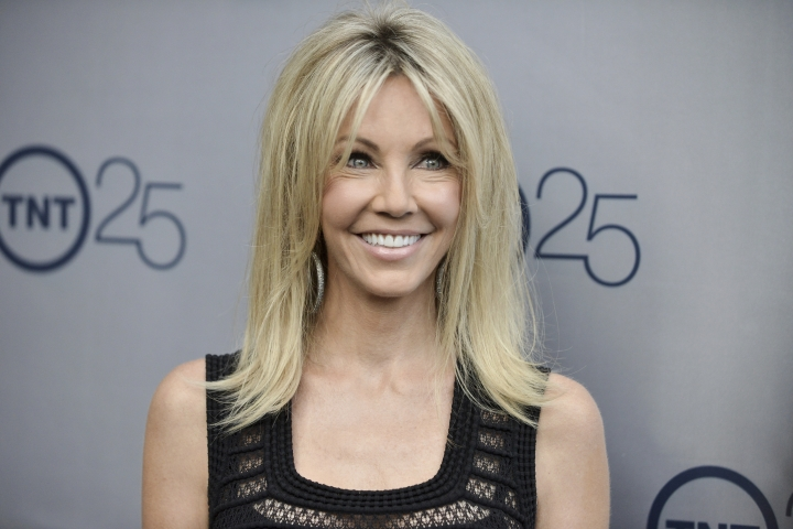 "FILE - In a July 24, 2013 file photo, Heather Locklear arrives at the TNT 25th Anniversary Party at The Beverly Hilton Hotel in Los Angeles. Locklear has been charged with several counts of battery against first responders who answered a domestic violence call at her Southern California home. The 56-year-old ""Melrose Place"" actress was charged Monday, March 12, 2018, with four misdemeanor counts of battery on an officer or emergency personnel, and one misdemeanor count of resisting or obstructing an officer. (Photo by Richard Shotwell/Invision/AP, File)"