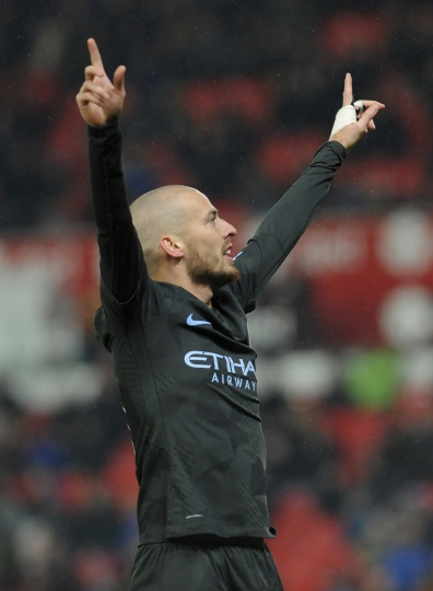 Manchester City's David Silva celebrates after scoring his second goal during the English Premier League soccer match between Stoke City and Manchester City at the Bet 365 Stadium in Stoke on Trent, England, Monday, March 12, 2018. (AP Photo/Rui Vieira)