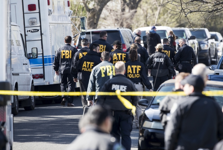 Authorities work on the scene after multiple explosions in Austin on Monday, March 12, 2018. Police are responding to another explosion Monday, that badly injured a woman, hours after a package bomb killed a teenager and wounded a woman in a different part of the city. (Ricardo B. Brazziell/Austin American-Statesman via AP)