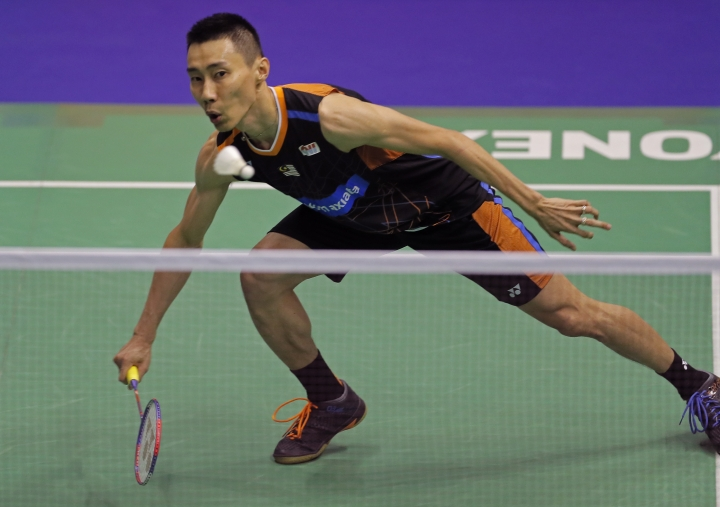 FILE -A Sunday, Nov. 26, 2017 file photo of Lee Chong Wei of Malaysia returning a shot to Chen Long of China in the final of the men's singles during the Yonex-Sunrise Hong Kong Open Badminton Championships 2017 in Hong Kong. Badminton greats Lin Dan and Lee Chong Wei look likely to contest a 40th instalment of their rivalry at the All England Championships starting on Wednesday. (AP Photo/Vincent Yu, File)