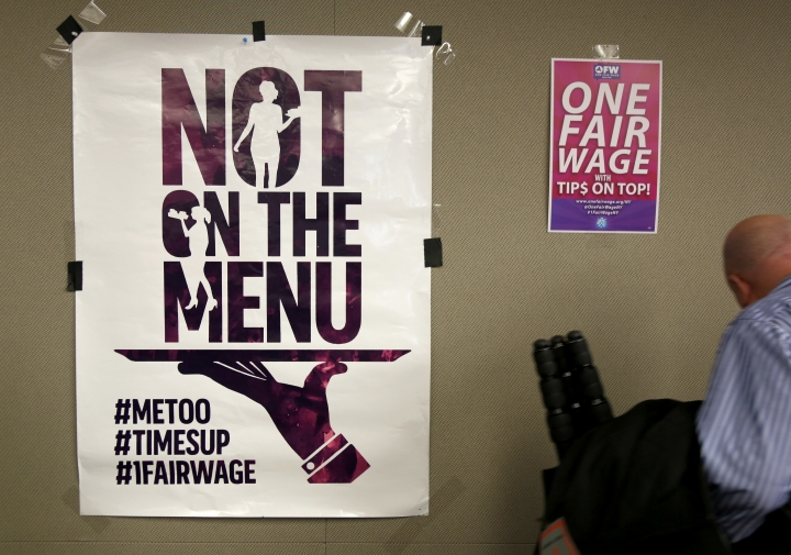 In this Feb. 20, 2018, photo, signs supporting fair wages and treatment are displayed at a discussion about subminimum wage workers that depend on tips for their living in New York. Activists are invoking the #MeToo movement in the push for more states to adopt higher minimum wages for tipped workers. They say a wage structure that leaves workers dependent on tips often forces them to put up with harassing and abusive behavior from their customers or risk not being paid. (AP Photo/Seth Wenig)