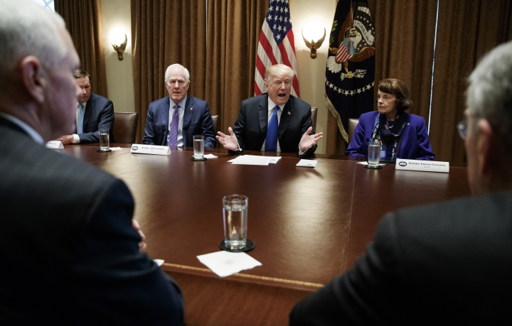 """FILE - In this Feb. 28, 2018, file photo, President Donald Trump speaks in the Cabinet Room of the White House, in Washington, during a meeting with members of congress to discuss school and community safety. With the president from left, Vice President Mike Pence, Sen. Chris Murphy, D-Conn., Sen. John Cornyn, R-Texas,, the president, Sen. Dianne Feinstein, D-Calif., and Sen. Chuck Grassley, R-Iowa. Not two weeks ago, Trump scolded a Republican senator for being """"afraid of the NRA"""" and declared that he would stand up to the powerful gun lobby and finally get results on quelling gun violence. Now Trump is striking a very different tone as he backpedals from his earlier demands for sweeping reforms.(AP Photo/Carolyn Kaster, File)"""