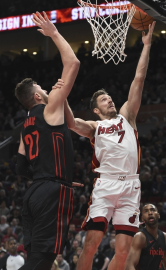 Miami Heat guard Goran Dragic (7) drives to the basket against Portland Trail Blazers center Jusuf Nurkic during the first half of an NBA basketball game in Portland, Ore., Monday, March 12, 2018. (AP Photo/Steve Dykes)