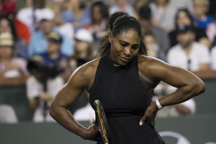 Serena Williams reacts after being scored on by opponent and sister Venus Williams during the third round of the BNP Paribas Open tennis tournament at the Indian Wells Tennis Garden in Indian Wells, Calif., Monday, March 12, 2018. Venus won the match. (AP Photo/Crystal Chatham)
