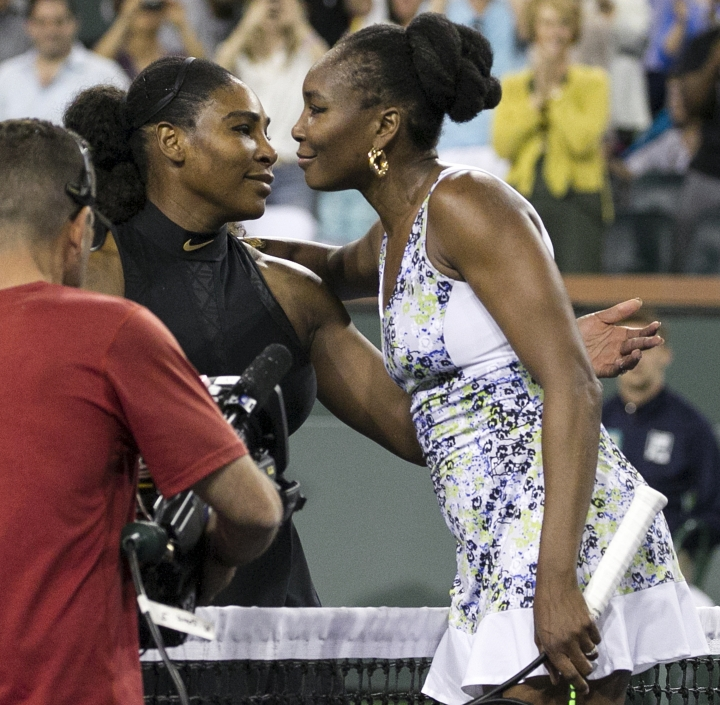 Venus Williams, right, hugs opponent and sister Serena Williams after defeating Serena in the third round of the BNP Paribas Open tennis tournament at the Indian Wells Tennis Garden in Indian Wells, Calif., Monday, March 12, 2018. (AP Photo/Crystal Chatham)