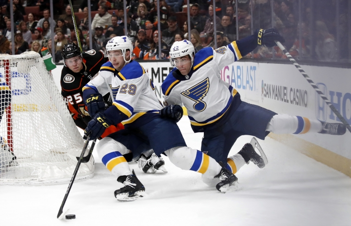 St. Louis Blues' Vince Dunn (29) collides with teammate Jordan Schmaltz, right, as he moves the puck past Anaheim Ducks' Ondrej Kase, of the Czech Republic, during the second period of an NHL hockey game Monday, March 12, 2018, in Anaheim, Calif. (AP Photo/Jae C. Hong)