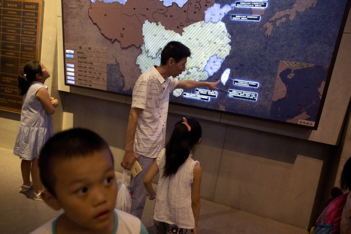 """FILE - In this Aug. 2, 2017, file photo, a man points out Taiwan to a young girl on a display titled: """"Humiliation in the history of the Chinese nation"""" depicting the territories that have been occupied or disputed by foreign powers in the 19th century including Taiwan and the South China Sea at a museum in Beijing. China's move to scrap term limits and allow Xi Jinping to serve as president indefinitely puts him on track to deal with some of the country's weightiest long-term sovereignty challenges, especially the fates of Hong Kong and Taiwan. (AP Photo/Ng Han Guan, File)"""