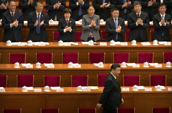 Chinese President Xi Jinping arrives for a plenary session of China's National People's Congress (NPC) in Beijing, Tuesday, March 13, 2018. China's rubber-stamp lawmakers on Sunday passed a historic constitutional amendment abolishing presidential term limits that will enable President Xi Jinping to rule indefinitely. (AP Photo/Mark Schiefelbein)
