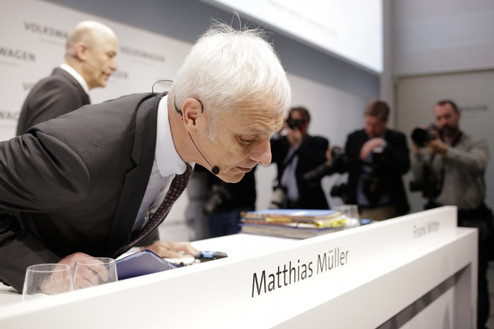 VW group CEO Matthias Mueller, front, and CFO Frank Witter, back ground left, arrive for the annual media conference of the Volkswagen group, in Berlin, Germany, Tuesday, March 13, 2018. (AP Photo/Markus Schreiber)