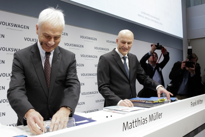 VW group CEO Matthias Mueller, left, and CFO Frank Witter, right, arrive for the annual media conference of the Volkswagen group, in Berlin, Germany, Tuesday, March 13, 2018. (AP Photo/Markus Schreiber)