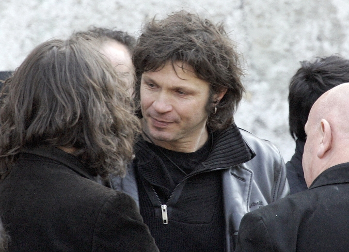 FILE - In this March 20 2009 file photo, French rock singer Bertrand Cantat, center, attends the funeral ceremony of French rock singer Alain Bashung in Paris. Cantat, who was convicted of killing his girlfriend 15 years ago, the actress Marie Trintignant, has pulled out from all the festivals he was scheduled to appear in this summer amid growing protests from feminist groups and politicans. (AP Photo/Francois Mori)
