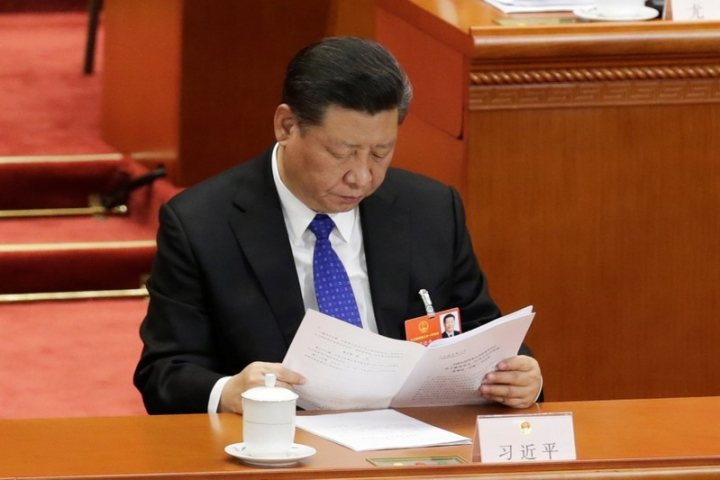 Chinese President Xi Jinping reads a report at the fourth plenary session of the National People's Congress (NPC) at the Great Hall of the People in Beijing, China March 13, 2018.  REUTERS/Jason Lee