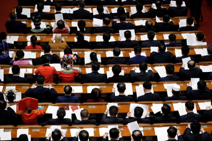 Delegates attend the fourth plenary session of the National People's Congress (NPC) at the Great Hall of the People in Beijing, China March 13, 2018.  REUTERS/Jason Lee