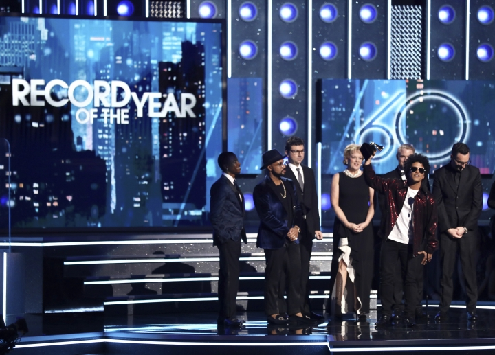 "FILE - In this Jan. 28, 2018 file photo, Bruno Mars accepts the award for record of the year for ""24K Magic"" at the 60th annual Grammy Awards in New York. Grammy viewership slipped below the 20 million mark, down 24 percent from 2017 and the music awards show's smallest audience since 2009. (Photo by Matt Sayles/Invision/AP, File)"