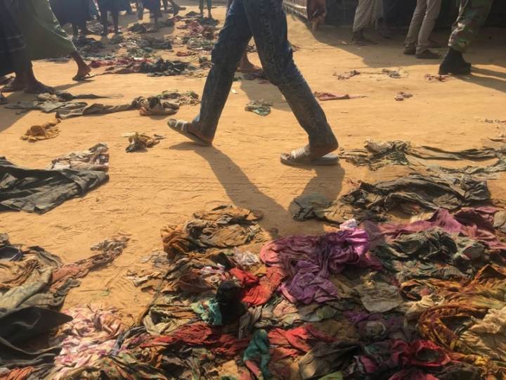 A man walks past ragged, donated clothes that have been discarded by Rohingya refugees at Kutupalong refugee camp in Bangladesh, February 12, 2018. REUTERS/Andrew RC Marshall