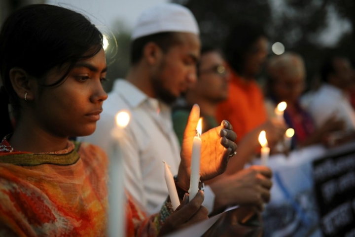People including Nepali students of University of Dhaka light candles in memory of the victims of the US-Bangla aircraft crash in Nepal in Dhaka, Bangladesh, March 13, 2018. REUTERS/Mohammad Ponir Hossain