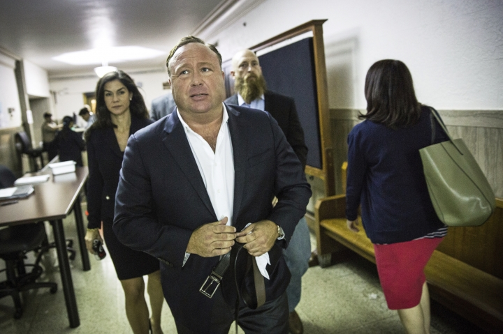 "FILE - In this April 17, 2017, file photo, ""Infowars"" host Alex Jones arrives at the Travis County Courthouse in Austin, Texas. Brennan Gilmore, a former State Department official who became the target of harassment after posting a video showing the car attack during a white nationalist rally in Charlottesville, is suing right-wing conspiracy theorist Alex Jones and others. Gilmore's defamation lawsuit was filed Tuesday, March 13, 2018, in federal court in Charlottesville, Va. (Tamir Kalifa/Austin American-Statesman via AP, File)/Austin American-Statesman via AP)"