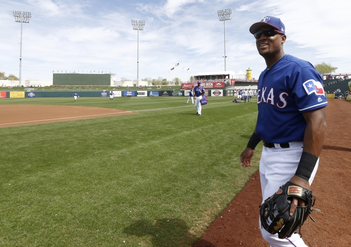 Texas Rangers third baseman Adrian Beltre smiles as he walk onto the field to warm up prior to the team's spring training baseball game against the Chicago White Sox on Thursday, March 8, 2018, in Surprise, Ariz. Of the more than 19,000 MLB baseball players that have appeared in a big-league game, only 156 have played 20 seasons in the majors. That includes only two current players who have reached the two-decade mark — third baseman Adrian Beltre and 44-year-old pitcher Bartolo Colon, teammates with the Texas Rangers. (AP Photo/Ross D. Franklin)