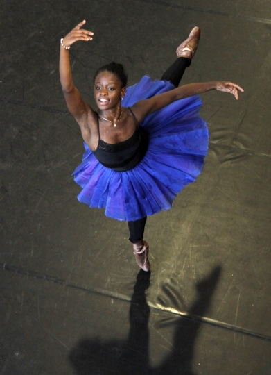 "FILe - In this July 10, 2012 file photo, dancer Michaela DePrince rehearses for her lead role in Le Corsaire in Johannesburg. Pop Star Madonna will direct a film based on DePrince's memoir ""Taking Flight: From War Orphan to Star Ballerina."" DePrince overcame a childhood in war-stricken Sierra Leone to become a world class ballerina. (AP Photo Denis Farrell, File)"