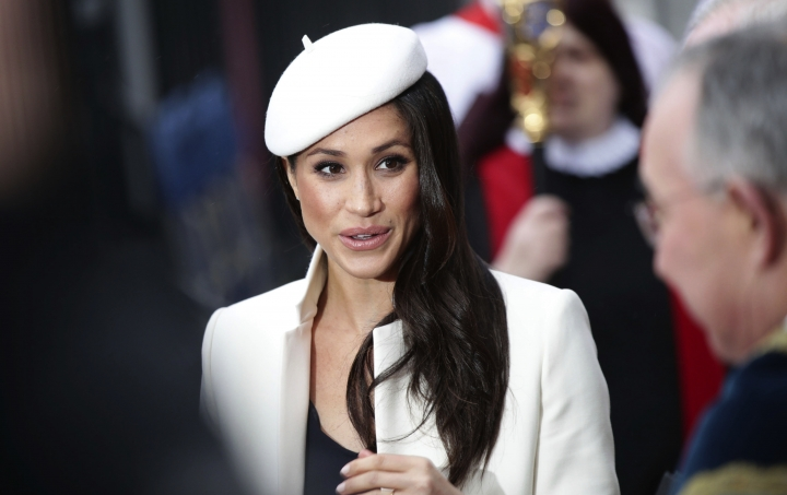 Britain's Prince Harry's fiancee Meghan Markle leaves the Commonwealth Service at Westminster Abbey, London Monday March 12, 2018. (Yui Mok/PA via AP)