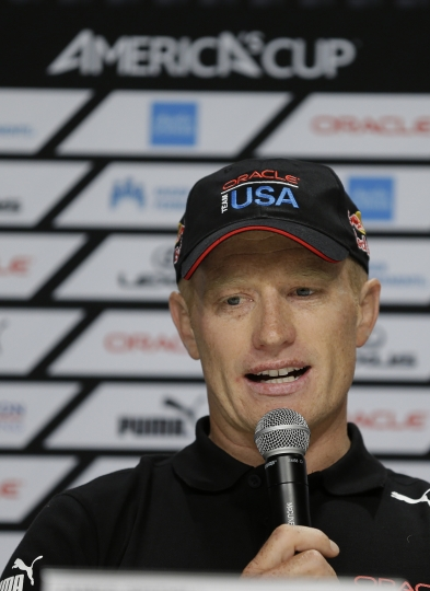 FILE - In this Sept. 5, 2013, file photo, Jimmy Spithill, skipper of Oracle Team USA, answers a question during a press conference at the America's Cup sailing event in San Francisco. Jimmy Spithill, who skippered Oracle Team USA to two landmark victories in the America's Cup, has joined Italian syndicate Luna Rossa. Luna Rossa, backed by the Prada fashion house, announced the hiring Tuesday, March 13, 2018. It's not clear whether Oracle Team USA's owner, tech billionaire Larry Ellison, will continue on in the America's Cup. (AP Photo/Eric Risberg, File)