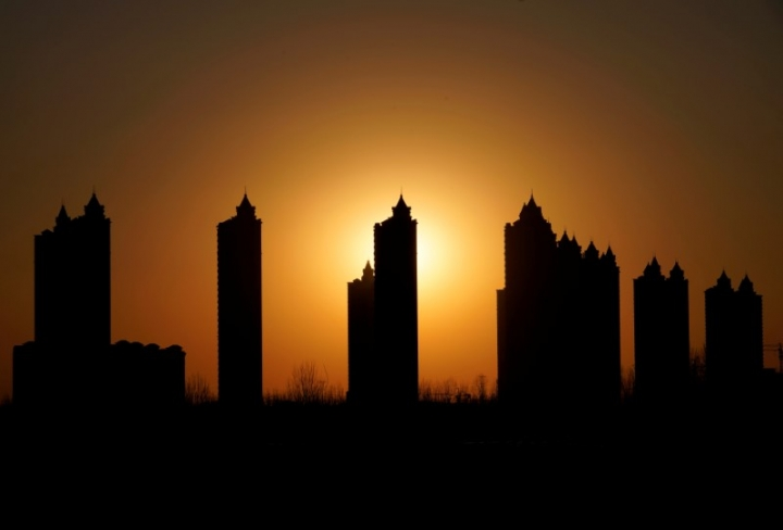 Apartments blocks are pictured during sunset on the outskirts of Tianjin, China February 2, 2018. Picture taken February 2, 2018. REUTERS/Jason Lee