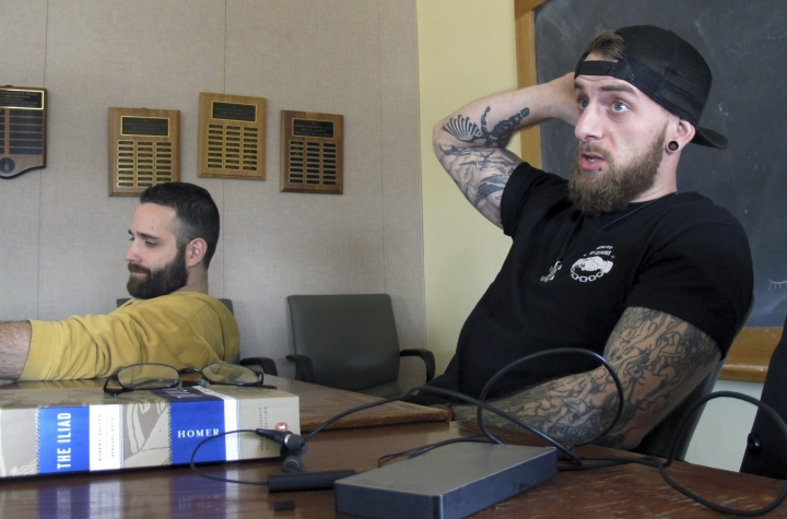 "In this Feb. 12, 2018 photo, University of Vermont student veterans Thomas Moore, left, and Dan Wright, participate in a class studying Homer's ""The Iliad"" and ""The Odyssey"" in Burlington, Vt. The Greek poet wrote in detail familiar to modern soldiers about the discipline of war and the difficulties many service members face when they return home. Homer-for-veterans is the brainchild of Dartmouth College classics professor Roberta Stewart, who is now hoping for a grant that will allow her to expand the idea nationwide. (AP Photo/Wilson Ring)"