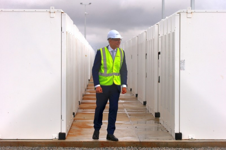 FILE PHOTO: South Australian Premier, Jay Weatherill walks around the compound housing the Hornsdale Power Reserve, featuring the world's largest lithium ion battery made by Tesla, during the official launch near the South Australian town of Jamestown, in Australia, December 1, 2017.   REUTERS/David Gray