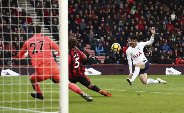Tottenham Hotspur's Son Heung-Min scores his side's second goal of the game against AFC Bournemouth during their English Premier League soccer match at the Vitality Stadium in Bournemouth, Sunday March 11, 2018. (John Walton/PA via AP)