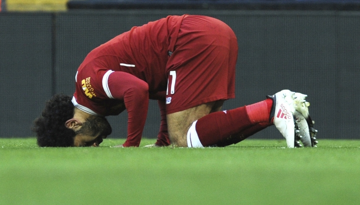FILE - In this Feb. 24, 2018 file photo, Liverpool's Egyptian star striker Mohammed Salah offers a prayer after scoring a goal during the English Premier League soccer match with West Ham United, in Liverpool, England. Egypt coach Hector Cuper is facing a new obstacle when it comes to preparing his team for this year's World Cup. The tournament in Russia starts on the final day of Ramadan, the holy month that requires Muslims to fast from sunrise to sunset. In comments published Wednesday, March 14, 2018, Cuper has said it would be up to the individual players to decide to fast. (AP Photo/Rui Vieira, File)