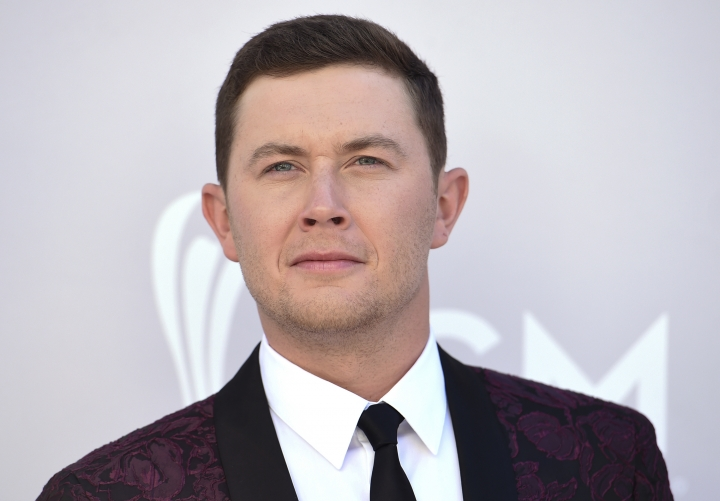 FILE - In this April 2, 2017 file photo Scotty McCreery arrives at the 52nd annual Academy of Country Music Awards at the T-Mobile Arena in Las Vegas. McCreery has finally earned his first No. 1 radio hit, along with a new label and new album. McCreery says he feels like he's starting over.(Photo by Jordan Strauss/Invision/AP, File)