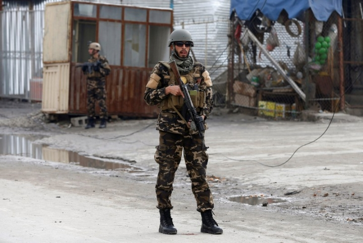 FILE PHOTO: A member of the Afghan security force keeps watch at the site of a suicide bomb attack in Kabul, Afghanistan March 2, 2018. REUTERS/Omar Sobhani/File Photo